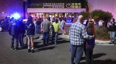 Sept. 17, 2016: People stand near the entrance on the north side of Crossroads Center mall between Macy's and Target as officials investigate a reported multiple stabbing incident  in St. Cloud, Minn.