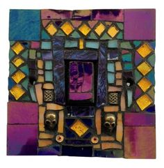 Light switch in purple, blue and yellow. This 'Skull' mosaic was hand crafted in Murano and Tiffany stained glass, providing a depth of colour and shimmer in any light.  This mosaic light switch comes with matching screws and with UK approved standard electrical fitting. Size 9 x 9 x 1.5 cm. Please feel free to send me a message on Pinterest for commissions.