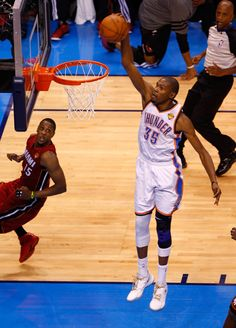 Kevin Durant of the Oklahoma City Thunder dunks the ball in the fourth quarter against the Miami Heat in Game One of the 2012 NBA Finals at Chesapeake Energy Arena on June 2012 in Oklahoma City, Oklahoma Kevin Durant Sneakers, Nike Air Max 2012, Baskets, Stephen Curry Shoes, Nike Headbands, Nike Spandex, Nike Quotes, Nike Soccer, Basketball Players