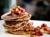 Food Network / Oatmeal Pancakes with Maple-Glazed Roasted Apples Recipe