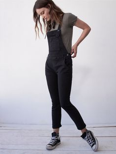Washed Denim Overall   Distressed wash skinny denim overalls. 5-pocket style. Adjustable crisscross straps. Pocket detailing on front bib.    * Please Note: The Black Clear Coating color features a coated effect, unlike the washed fabric on the other colors.