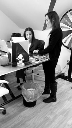 Alicia and Irena going over some files