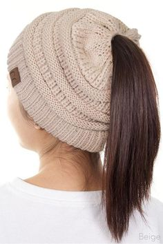 Not your average Beanie! These are made out of Stretchable soft acrylic with a place for your ponytail! Visit leemaries.com for more colors