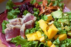 UnCobb Salad w/Seared Tuna, Avocado, Mango, Dried Cranberries, & Pecans. A modern spin on the traditional Cobb Salad!