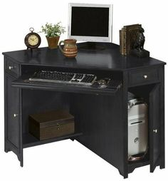 """Oxford 50""""w Corner Computer Desk, 30""""Hx50""""W, BLACK by Home Decorators Collection. $289.00. 30""""H x 50""""W x 35""""D.. Assembly required.. With a convenient space-saving design, the Oxford Corner Computer Desk is an excellent choice for any home. The wide surface area on top will hold your computer monitor and other items while a pull-out tray is perfect for your keyboard. Carefully crafted of smooth hardwood veneer, this home office furniture also comes in your choice..."""