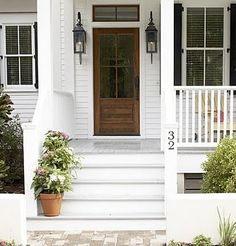 Painted front door or natural wood? Can't decide which I like better.
