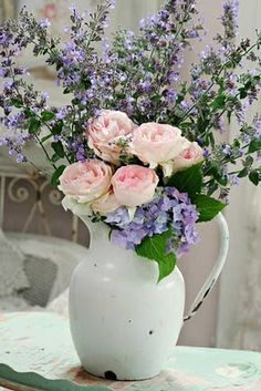 I love the beauty of a favorite pitcher filled with simple flowers. A simple centerpiece that bring freshness and joy to mind and to your table