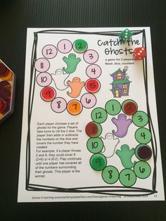 Spiders Cover an Addition - players find any 3 numbers in a row that will make an addition equation. Halloween math board game from Halloween Math Games Second Grade by Games 4 Learning $