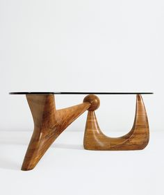 Isamu Noguchi; Stack-Laminated Rosewood and Herculite Plate Glass 'Goodyear' Coffee Table for A. Conger Goodyear, 1939.