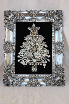 Christmas tree made of garage sale brooches then put into a nice frame.