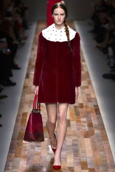 """FALL 2013 READY-TO-WEAR  Valentino /   Vermeer's Girl With a Pearl Earring stared out from Maria Grazia Chiuri and Pierpaolo Piccioli's mood board this season. At a preview, the Valentino designers were making connections between what they called the severe yet sensual portraits of the Dutch masters and their exquisite new collection for Fall. """"We wanted to capture women in a private moment,"""" Chiuri said. """"In this show, the face is very important""""—as it was for Vermeer and company."""