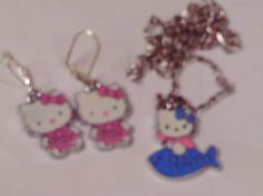 Hello Kitty Riding a fish Necklace/Earrings