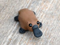 Tiny platypus - Handmade miniature polymer clay animal figure