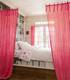 sheer drapes divide a sleeping space- This may be an option to hang the curtains with wire if your room doesn't allow a rod.