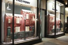 Each of the houses have numbered advent doors and one is opened every day to reveal a different Fred Perry product.