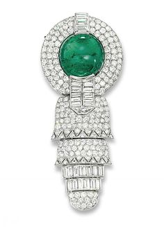 AN ART DECO EMERALD AND DIAMOND EPAULETTE BROOCH, BY BOIVIN Of geometric design, the central cabochon emerald to the pavé-set diamond circular surround with baguette-cut diamond detail suspending a similarly set articulated stylised tassel, circa 1930, 8.0 cm long, with French assay marks for platinum, in later fitted grey suede Boivin case