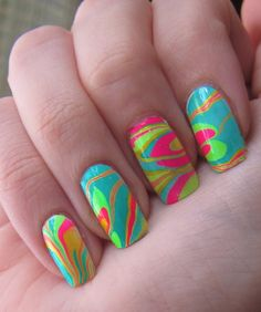 "Best thing about this photo is the caption, ""Neon watermarble from Hunger Games Morphling Manicure tutorial"""