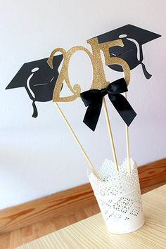 Graduation Centerpiece is so sophisticated and chic! Use these graduation cap and 2015 wands alone in a vase or pair them with a bouquet of flowers. Either way, they will make a great focal point at your graduation party.