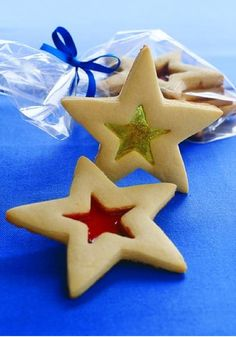 Stained Glass Cookies — For a fun family activity, fill the centers of cutout cookies with crushed hard candies. The candies melt during baking to resemble stained glass.