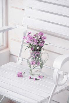 little purple flowers, white chair