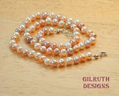 This beautiful, lustrous necklace was hand knotted using white silk beading cord and freshwater potato pearls