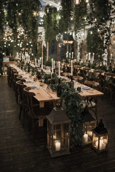 Pretty wedding decor idea using greenery and lanterns