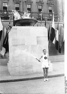 German runner with the Olympic flame at the Lustgarten, Berlin, Germany, Aug 1936
