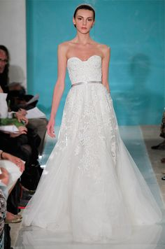 "This Reem Acra Heavenly Lace dress was purchased in 2014 from ""The White Dress"" - a bridal boutique located in the City of Corona Del Mar. The wedding dress retailed for $6,500 in Spring 2013 and was"