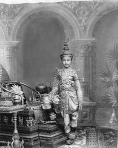 A young Siamese prince in the early 20th century displays traditional, full court regalia. Plays and films like Anna and the King of Siam popularized Thai royalty among Westerners. In 1932 Thailand changed from an absolute to a constitutional monarchy.