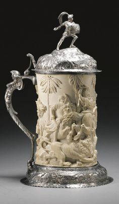 A dramatic silver-mounted carved ivory hunting tankard, German, circa 1875
