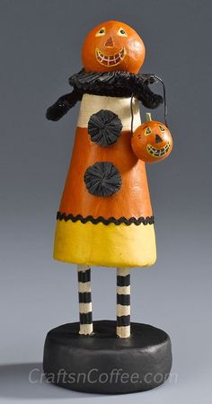 Rebekah Meier made this beautiful folk art Candy Corn Girl.  Her tutorial on Crafts 'n Coffee makes it look pretty easy.