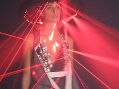*pew*pew!* We don't sell laser products, but I sure love this laser dress & space age hat. She's like a living breathing walking RAVE down the runway! WOW, says this high fashion frock had 200 moving lasers on it. Fancy.