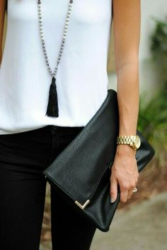 Formal: black trousers, silk vest, long necklace, black sandals, clutch
