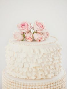 Ruffled cake topped with roses