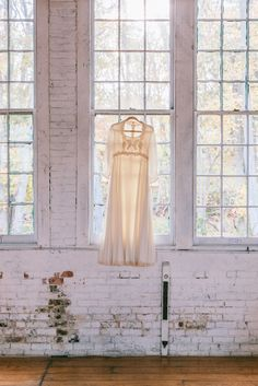 Mother of the bride's wedding dress on display | Rachel & Ben's Lace Factory Connecticut Wedding | Sweet Little Photographs