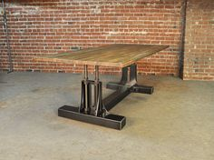Base price includes a 96 x 40 steel top  Also pictured is a 20' x 3' table with a reclaimed boxcar oak top. It has 3 bases for support, and bolted corner metal trim around the wood top.  Standard top size: 96 x 40 or 120 x 48  Casters optional, standard sizes use 4 casters  Standard Height: 30 or 42  Please note that all wooden tops manufactured by Vintage Industrial include a 3 - 6 breadboard on both ends of the table to prevent warping of hardwoods.