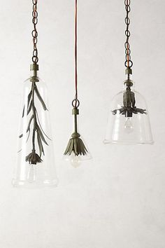 These Iron Petals pendant lamps are simple, organic, pretty -- and a little tough. Iron flower in a clear glass cloche. By Philadelphia artist Robert Ogden (Lostine), through Anthropologie.