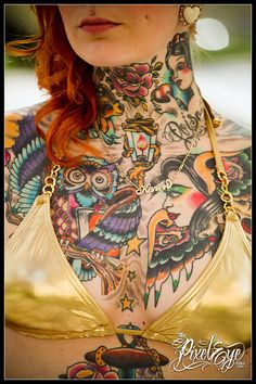 Many beautiful tattoos  <3 the rose at her throat and the wise owl with a book.