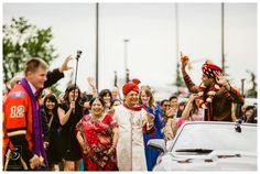 Groom with his parents during the Barat at Calgary East Indian Wedding. Photography by Sujata Photography.