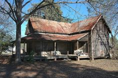 """View of the corner of the wrap-around front porch; the """"Annie House"""", TattnallCounty, GA. Photographed by Brian Brown for his website, Vanishing South Georgia."""