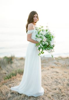 Off-the-shoulder sexy: http://www.stylemepretty.com/2015/08/01/21-elegant-sexy-wedding-dresses-that-will-make-his-jaw-drop/
