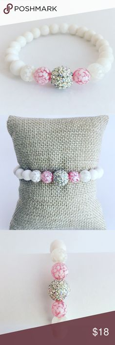 Handmade White & Pink Beaded Bracelet FREE GIFT WITH EVERY ORDER! This bracelet is the kind of classic you can wear stacked or solo. This bracelet is stretchy & looks chic worn solo or paired with similar styles.  • 6mm White Gemstone Beads • 6mm Pink Glass Beads & 8mm CZ Bead • Size 7 inches   If you need another size, please let me know. Each bracelet is authentically handmade by me in my home craft studio.  I weave professional grade elastic cord through the beads to ensure beautiful…