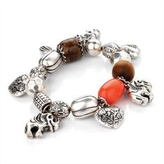 Minerva Collection Elephant Charm  Bead Fashion Bracelet Burnt Silver  Coral  Price : £8.00 http://www.minervacollection.com/Minerva-Collection-Elephant-Fashion-Bracelet/dp/B007NFVCIO