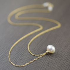 Mothers day gifts for her // Simple, elegant, timeless white pearl necklace. This pretty pendant features a white, oblong freshwater pearl. The lustrous AAA-grade pearl pendant moves freely on gold filled chain. shopsouthpaw.com