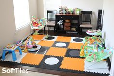 A modern playroom floor using SoftTiles Playroom Black, Gray, and White Circles with Orange and White Foam Mats #playroomdecor