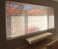 """A picture window in a Palm Springs house covered with Delia Shades' """"Square Lattice"""" pattern. Get a free estimate for your own project at http://www.deliashades.com/quote.php #SquareLattice #Lattice #PictureWindow #SolarShades #DeliaShades #WindowTreatments"""