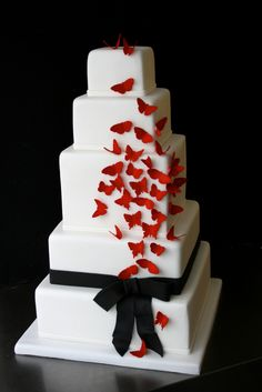 Who says you have to use flowers on your cake? These red butterflies are whimsical and elegant on this classic square cake.