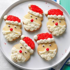 Santa Claus Sugar Cookies Recipe -I've used this recipe for almost 40 years and love it because it's a little different than most. My mom always made Santa cookies, and we'd put them into little clear bags tied with ribbon to hang on the tree.—Ann Bush, Colorado City, Colorado