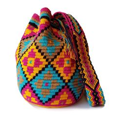 $49.90-$52.90 #Wayuubags. These double thread small mochila bag are perfect for carrying around a few items such as your phone, wallet and a few other necessities. They also make a very cute gift for younger women and young girls. The colors of these mochilas Wayuu are inspired by the vivid colors that surround region of La Guajira. All Wayuu bags come with a handwritten postcard, and little gift. The time required to elaborate a Wayuu Mochila varies from 4-7 days.  www.lombiaandco.com Gifts For Young Women, Tapestry Bag, Crochet Handbags, Phone Wallet, Filet Crochet, Little Gifts, Cute Gifts, Cross Stitch Embroidery, Mumbai