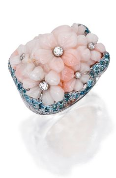 *18 KARAT WHITE GOLD, CORAL, DIAMOND AND AQUAMARINE RING, MICHELE DELLA VALLE The carved coral bouquet within a floral mounting, set with round diamonds weighing approximately 1.15 carats, accented by round aquamarines, size 5¾, signed Michele della Valle, numbered 130727.
